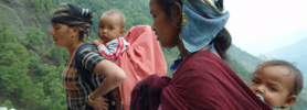 Women carrying their babies in the mountains